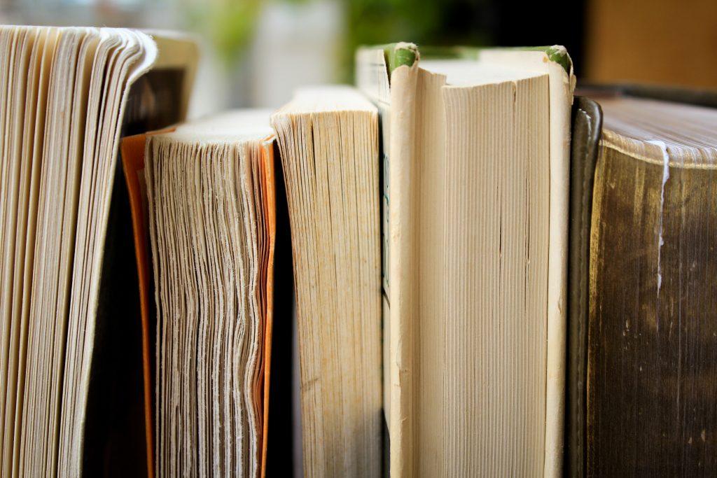 a row of books on a bookshelf